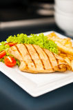 Chicken, French fries and salad Stock Image