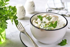 Chicken fricassee with green pea served with boiled rice. Stock Images