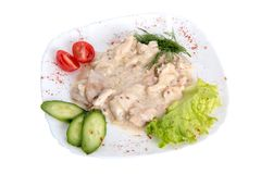 Chicken Fricassee with Green Vegetables on white royalty free stock photo