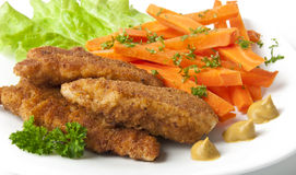 Chicken fried. In breadcrumbs with vegetables Stock Images