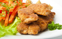 Chicken fried. In breadcrumbs with vegetables Stock Photography