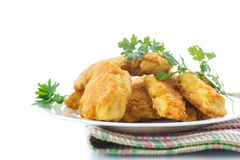 Chicken fried in batter. On a white background stock images