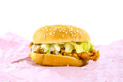 Chicken fried burger on pink paper Royalty Free Stock Images