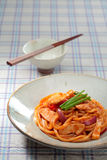 Chicken fried noodles on classic chinese bowl with chopsticks on Royalty Free Stock Photography