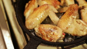 Chicken fried in a pan With toasted crust stock video footage