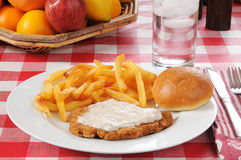 Chicken fried steak with a basket of fruit Stock Photography