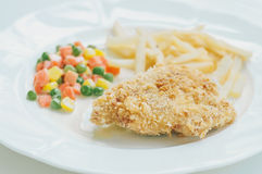 A chicken fried steak with french fries and vegetables Royalty Free Stock Images