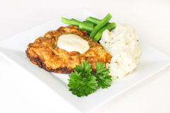 Chicken fried steak. Southern meal of pan fried steak served with cream gravy and a side of mashed potatoes and green beans stock photography