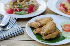 Chicken fried in white dish and papaya salad Stock Photos
