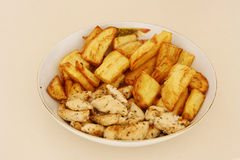 Chicken and Fries. Fried potatoes and roasted chicken Royalty Free Stock Images