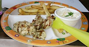 Chicken with fries and coleslaw Royalty Free Stock Photography