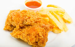 Chicken with fries and sauce Stock Images