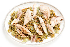 Chicken with frikeh serving dish from above Stock Photo