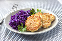 Chicken fritters and stewed red cabbage with caraway Royalty Free Stock Photos