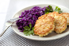 Chicken fritters and stewed red cabbage with caraway seeds Royalty Free Stock Photo