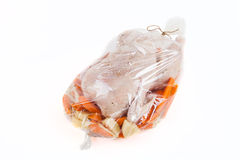 Chicken for frying with vegetables in a package Stock Photo