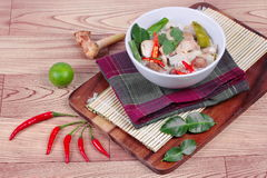 Chicken and galangal in coconut milk soup and herb . Side view Stock Photo