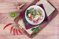Chicken and galangal in coconut milk soup and herb . Top view Stock Image