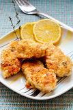 Chicken in garlic breadcrumbs. Some fragrant golden chicken on a plate with a sprig of thyme royalty free stock photography