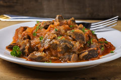 Chicken gizzard stew on plate Stock Images