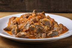 Chicken gizzard stew on plate Stock Image