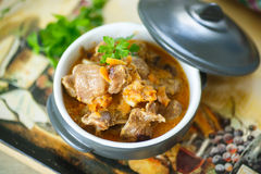 Chicken gizzards stewed with vegetables Stock Photo