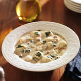 Chicken and gnocchi soup in a bowl Stock Images