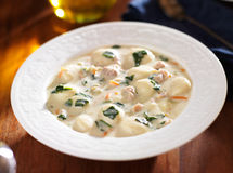 Chicken and gnocchi soup in a bowl close up Stock Photography