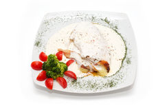 Chicken with gorgonzola, vegetables and bread on the plate Royalty Free Stock Photos