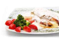 Chicken with gorgonzola, vegetables and bread on the plate Stock Photo