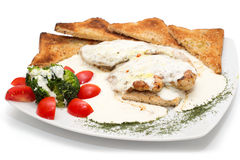 Chicken with gorgonzola, vegetables and bread on the plate Royalty Free Stock Images