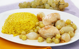 Chicken with grapes Stock Photos