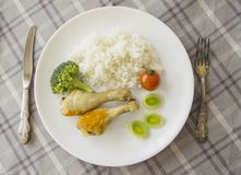 Chicken greek  legs with rice on served table Stock Photo