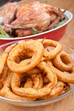 Chicken with green beans and onion rings Royalty Free Stock Images