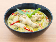 Chicken green curry on wooden background Stock Photography