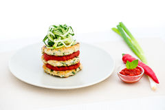 Chicken griddle-cake with Thai herbs, tomato chilli jam and cucumber noodles Stock Photo