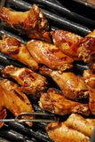 Chicken on grill Stock Photos