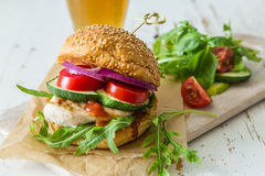 Chicken grill burger on wood background Royalty Free Stock Photo