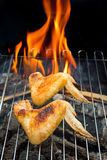Chicken on grill Stock Images