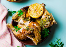 Chicken a grill with a lemon Stock Photography