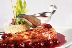 Chicken grill with rice and cherry sauce Stock Image