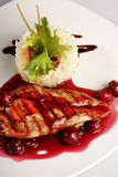 Chicken grill with rice and cherry sauce. Closeup. Top view Royalty Free Stock Photos