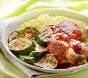 Chicken with grilled courgette tomato sauce and rice Royalty Free Stock Image