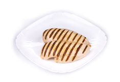 Chicken grilled fillet with slices on plate. Royalty Free Stock Photography