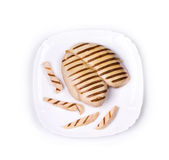 Chicken grilled fillet with slices on plate. Stock Photography