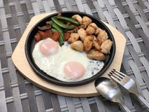 Chicken grilled with Fried egg and Vegetable on Hot pan and wood plate Diet Dish for advertising menu at restaurant. food. Background stock photos
