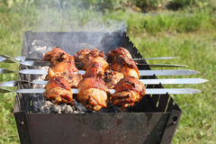 Chicken grilled on skewers Royalty Free Stock Photography