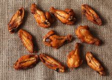 Chicken grilled wings on a linen tablecloth Stock Photo