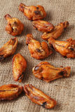 Chicken grilled wings on a linen tablecloth Royalty Free Stock Image
