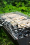 Chicken grilling on the brazier Stock Photography